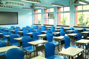 classroom desks with blue chairs