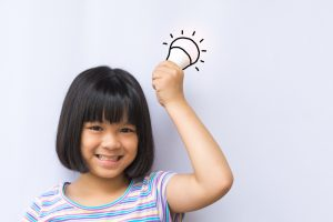 girl holding idea light bulb