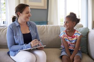 therapist and girl smiling