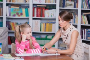 therapist with young girl