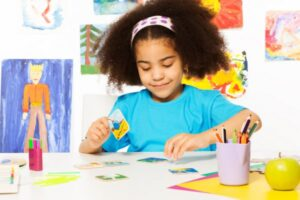 young girl working on a creative art project